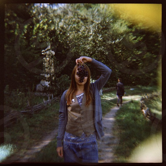Anya portrait with grapes. Summer in Moldova. 120mm Diana with light defects. photo