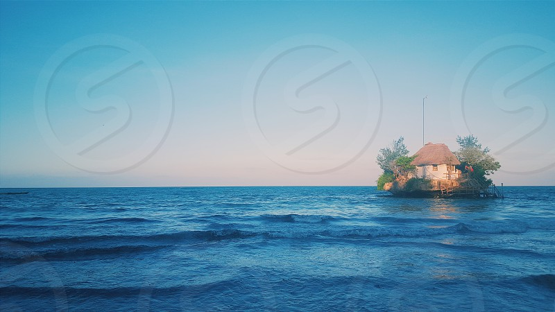 restaurant called The Rock off the east coast of zanzibar on coral rock in the Indian Ocean photo