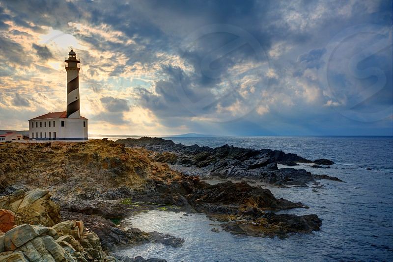 Cap de Favaritx sunset lighthouse cape in Mahon at Balearic Islands of Spain photo