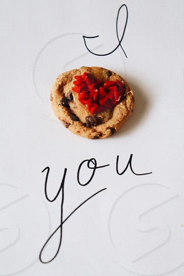 i love you with cookie on white surface photo
