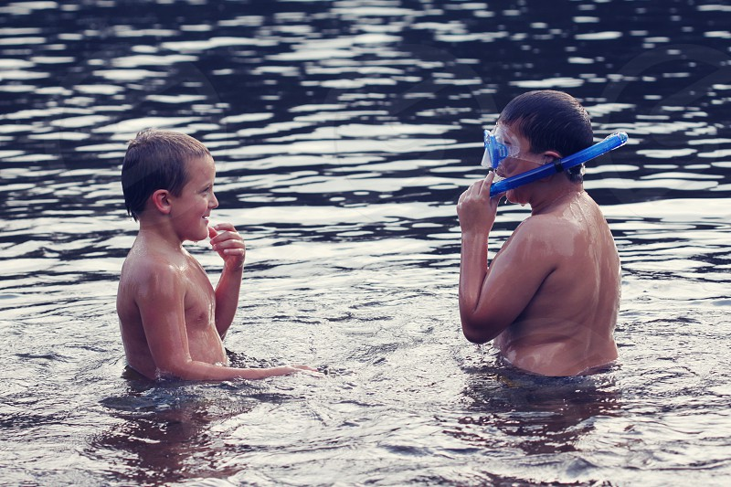 Boys playing in a lake in up north Michigan lots of fun photo