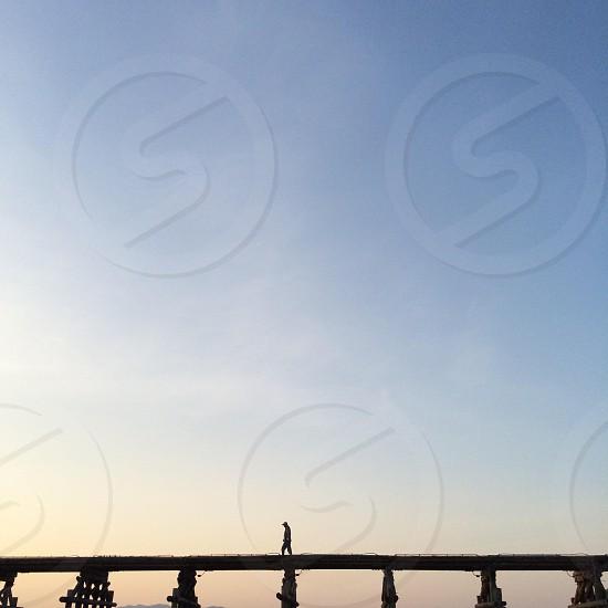 person in white bridge platform photo