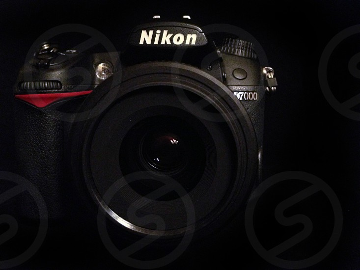 black nikon dslr camera photo