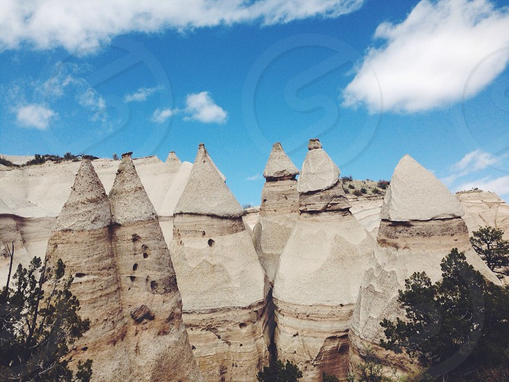 gray stone cone formations under blue sky photo