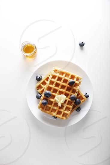 bluberry; waffles; butter; honey; breakfast photo