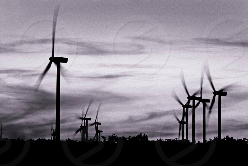 alternative; black and white; blade; cloud; clouds; cloudy; electric; electricity; energy; environment; generate; generator; green; mast; metal; mill; nature; power; propeller; protected; renewable; rotate; rotating; rotation; sky; spin; spinning; stand; turbine; watts; white; wind; windmill; wings photo