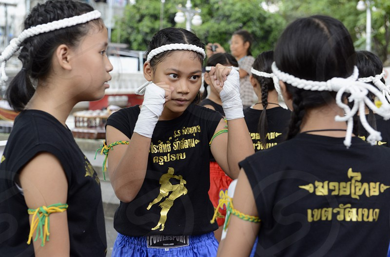 a traditional Muay Thai Box Show at the Santichaiprakan Park at the Mae Nam Chao Phraya River in Banglamphu at the city of Bangkok in Thailand in Suedostasien. photo
