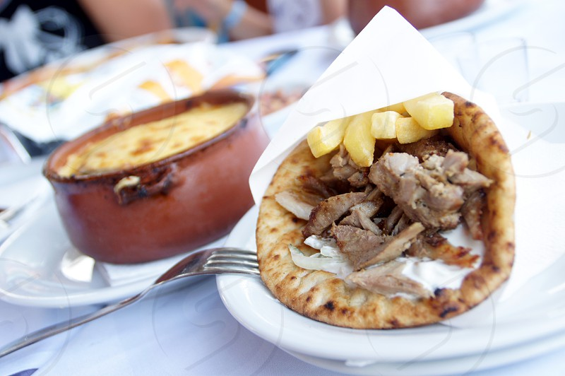 Greek dinner - Gyros and meat pot photo
