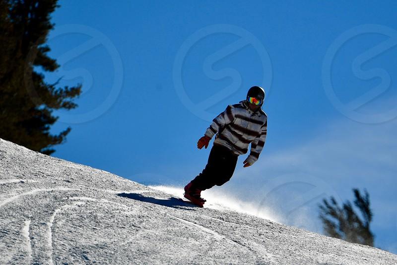Winter adventure snowboarding downhill photo