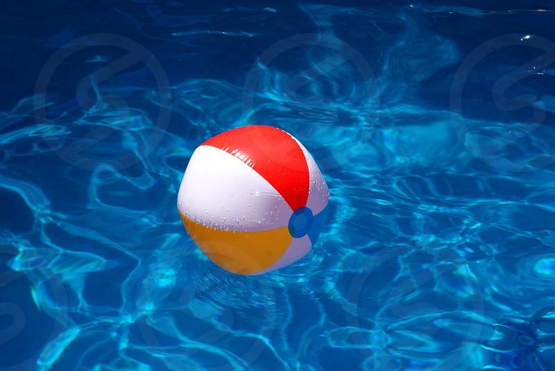Beach ball floating in pool photo