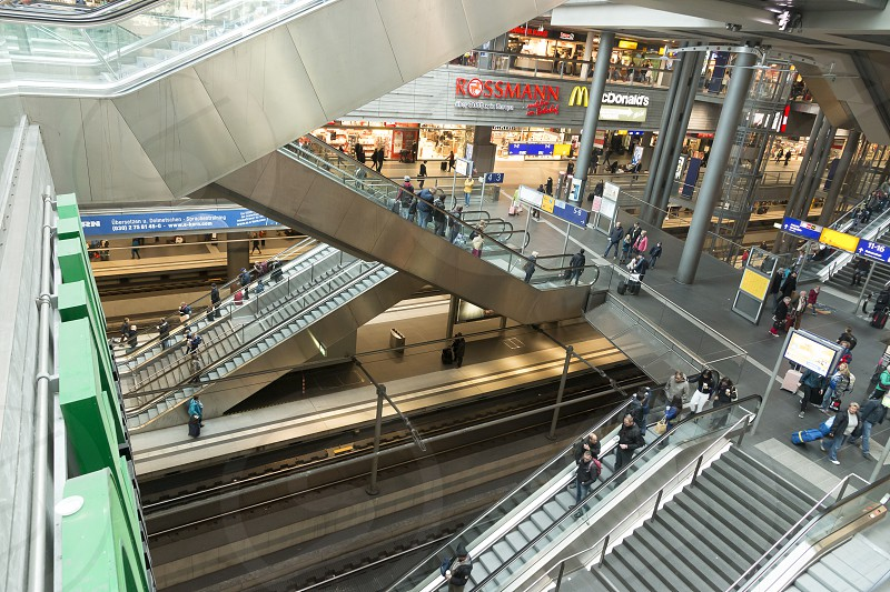 Interior of the Berlin Hauptbahnhof with escalators and rails. photo