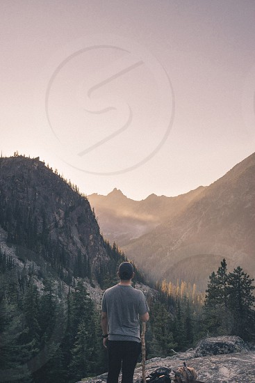 Mountain man hiking sunset Washington  photo