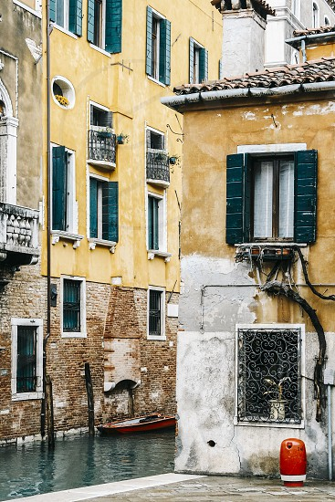 venice veneto italy buildings canal canals old brick crumbling patina yellow ochre red windows photo