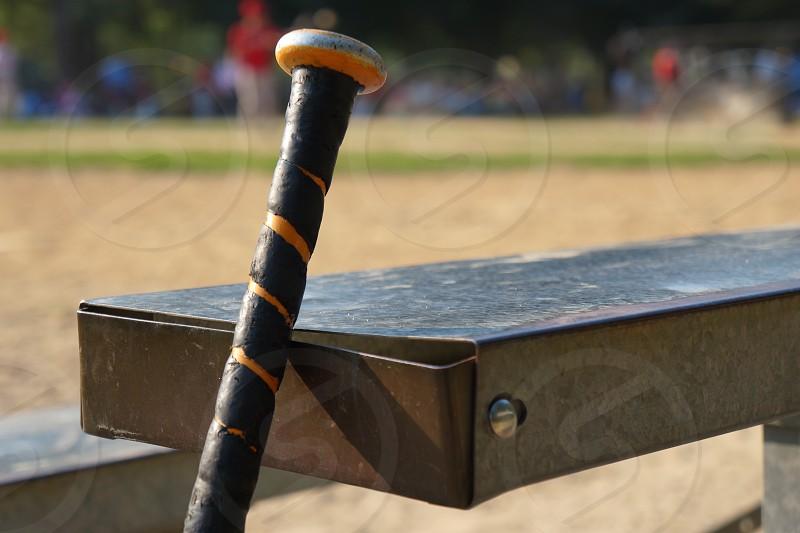 black and orange metal baseball bat photo