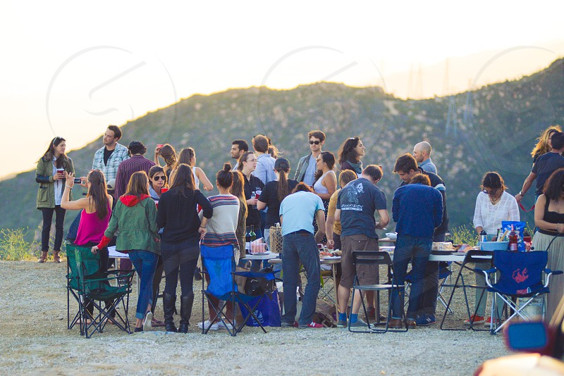 creative gathering artists sunset dinner party outdoors mountains photo