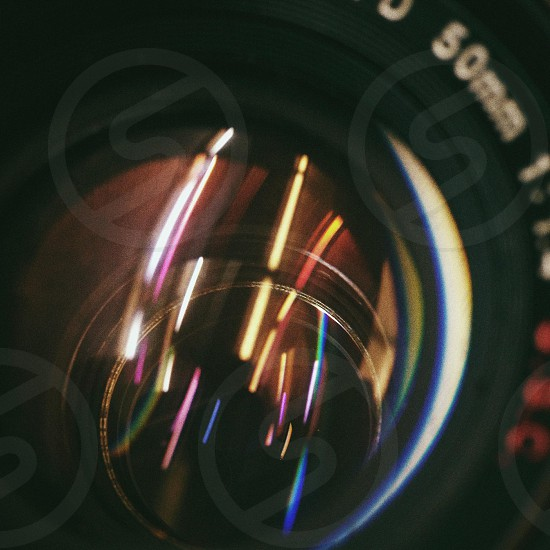 Neon reflections in my analog camera lens. photo
