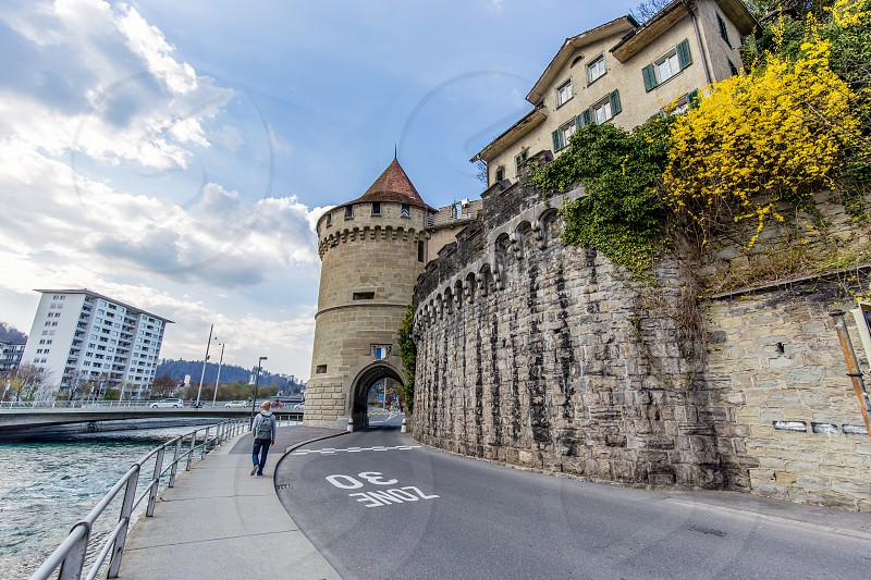 Pedestrian walking along Lucerne's medieval Musegg Wall photo