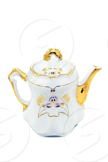 Antique coffee pot in Art nouveau style on white isolated background. photo