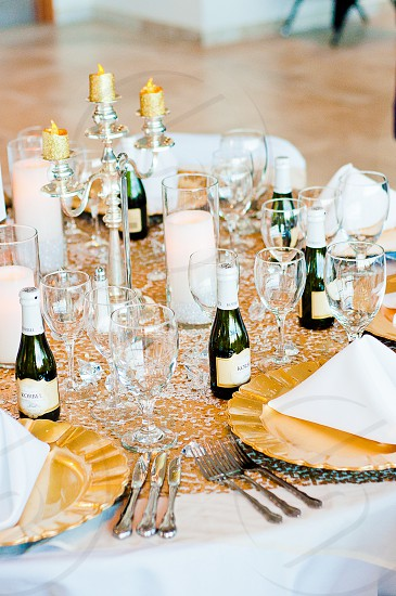 "White & Gold centerpiece for a fundraiser benefit dinner.  This table is specifically the ""white and gold"" table. photo"