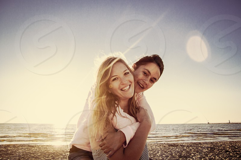 man hugging woman by the beach photo