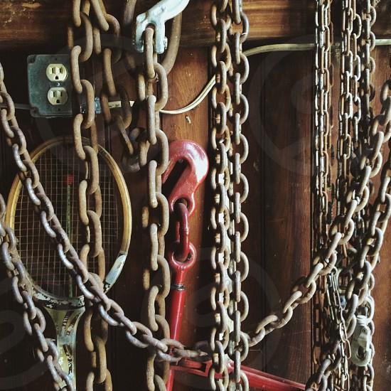 Chain link heavy burden barn garage collection tennis racquet photo