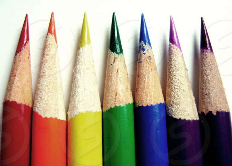 red orange yellow green blue and purple colored pencils photo