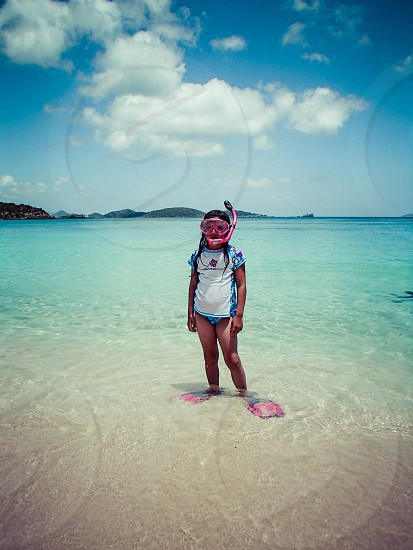 young snorkeler ready to dive in photo