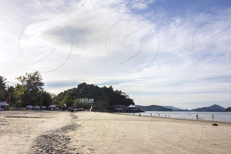 pantai cenang is a very popular beach in langkawi island malaysia photo