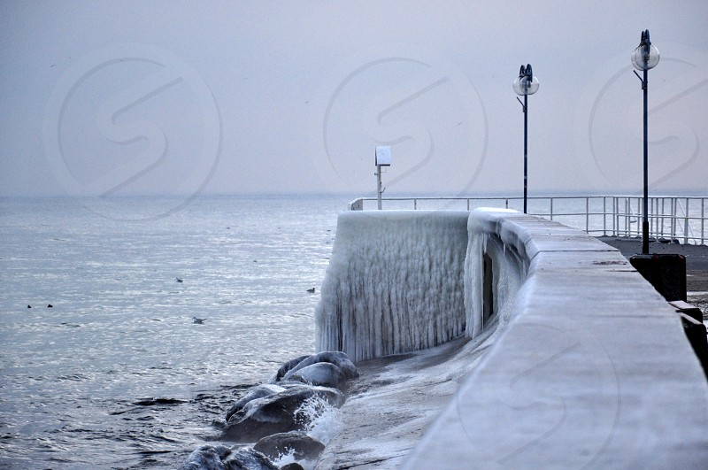 Frozen pier at the baltic sea coast  photo