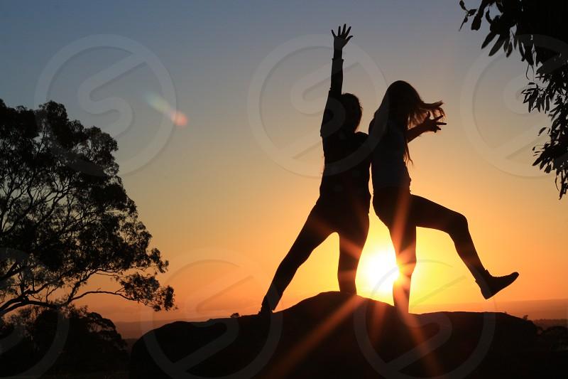sun sunset girls lens flare silhoettes photo