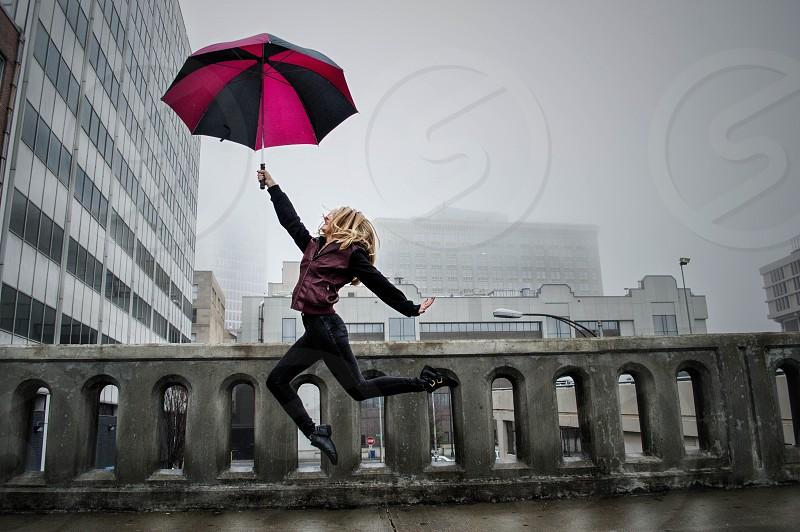 Freedom umbrella rain jump portrait girl photo