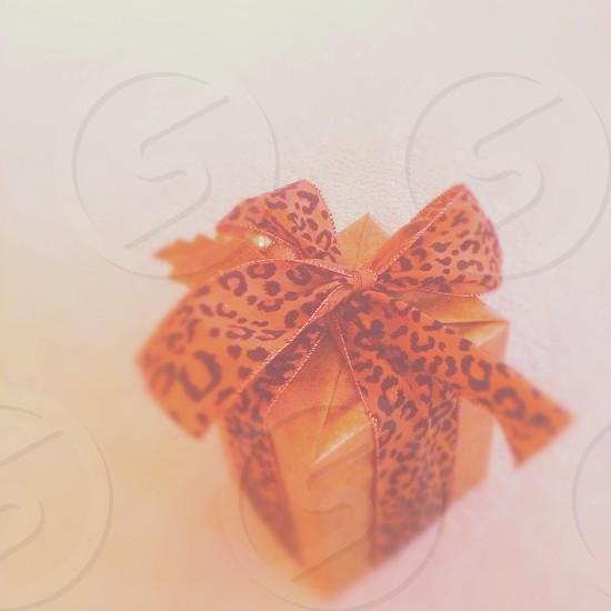 orange ribbon printed with black scribbles photo