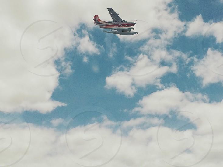 red & white boat plane photo