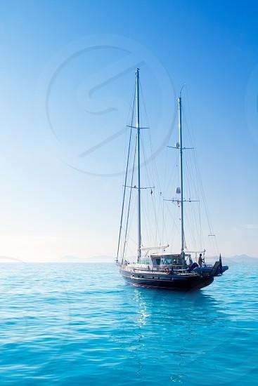 anchored sailboats in turquoise Formentera Illetes beach near Ibiza photo