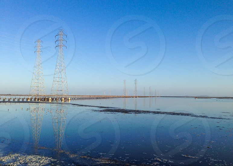 Towers for power lines over the water photo