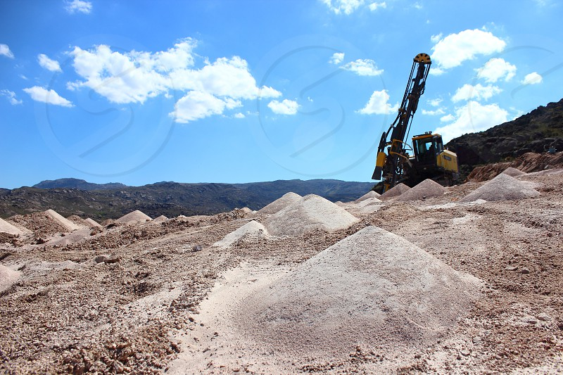 drilling rocks at top mountain in minning industry photo