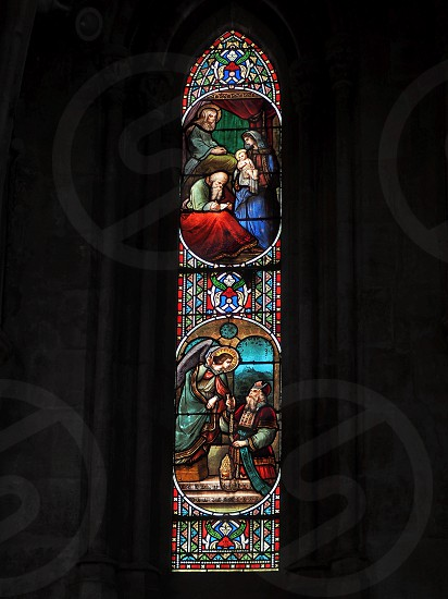Stained Glass Window in the Basilica St Seurin in Bordeaux photo