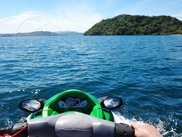 Driving a jet ski in the Pacific Ocean in Costa Rica               photo
