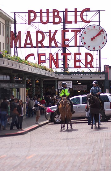 Seattle Pike Place Market police horses shopping tourism photo