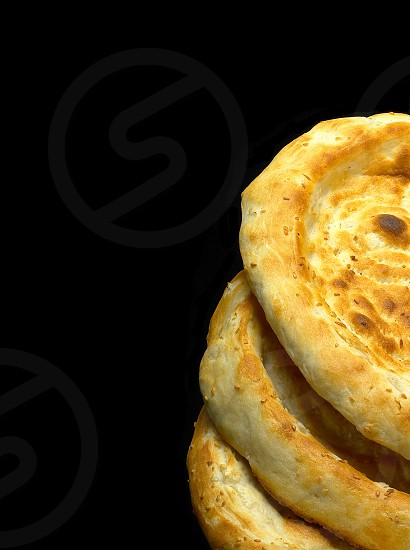 fresh just made traditional uzbek bread close up photo