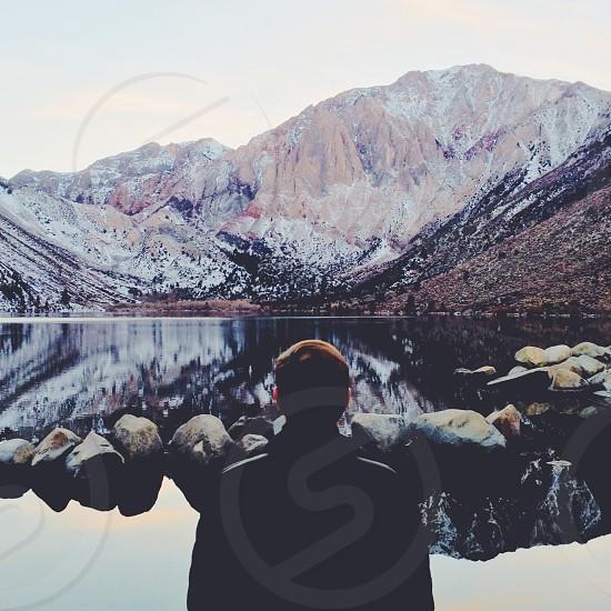 man standing on lake photo
