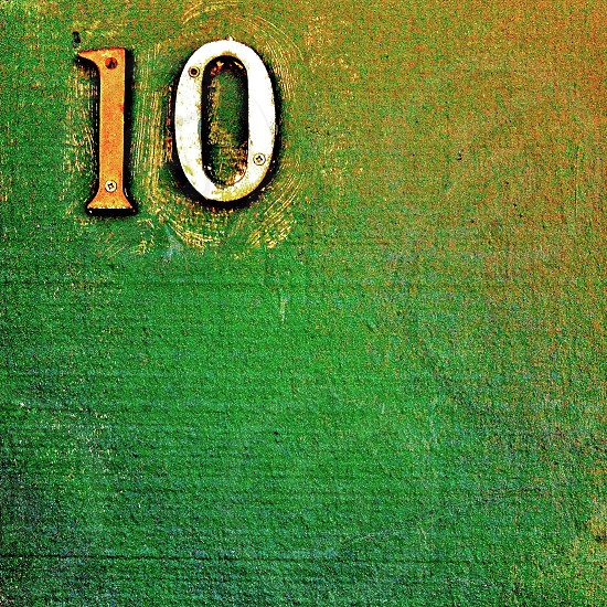 Number 10 on a green wall.  photo