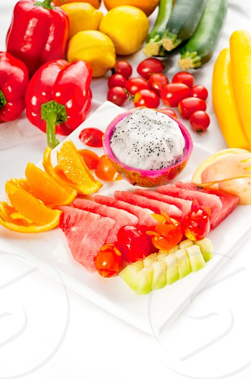 mixed plate of fresh fruitspitaya or dragon fruit with watermelon orangeapple and cherry tomatoesMORE DELICIOUS FOOD ON PORTFOLIO photo