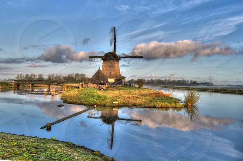 windmill oterleek reflection clouds photo