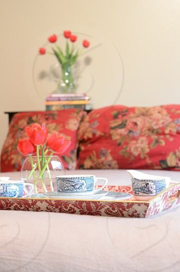 Bed linens red tulips china breakfast in bed photo