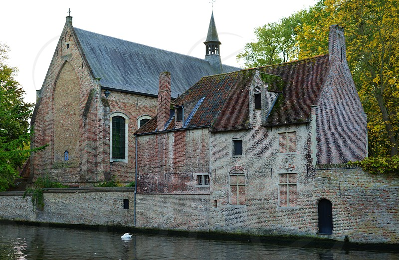 The Beguinage in Bruges Belgium photo