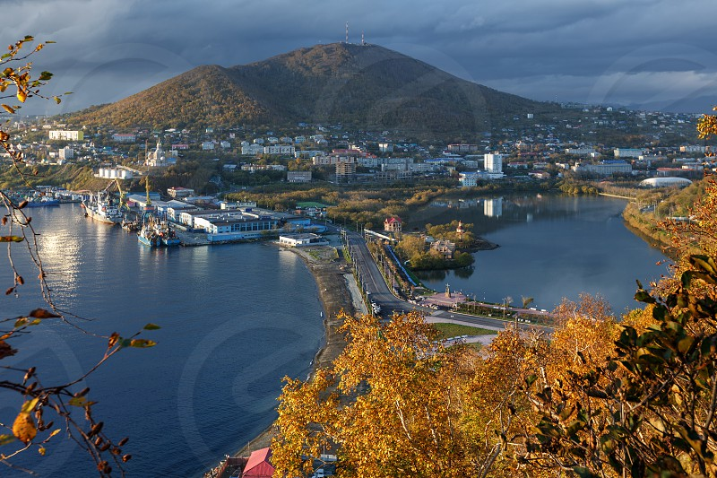 Kamchatka city landscape: autumn view of Petropavlovsk-Kamchatsky City and seaport on shore of Avachinskaya Bay (Avacha Bay) in Pacific Ocean. Kamchatka Region Russian Far East Eurasia. photo