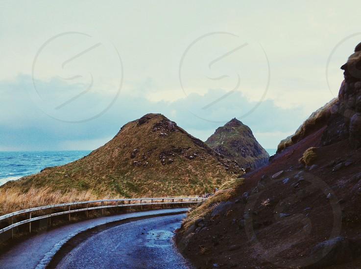 asphalt curve road with 2 mountain  photo