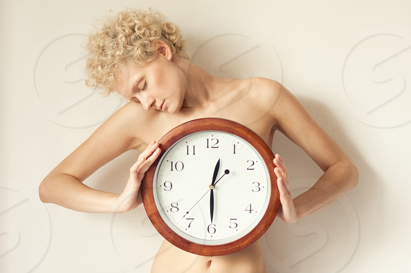 Beautiful woman holding clock time concept photo