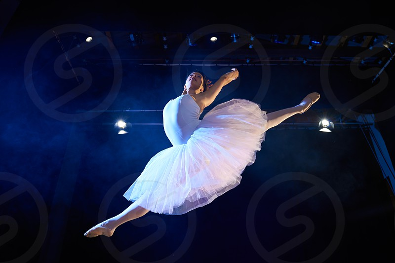 dancer; dancing; fly; classic; ballet; high; jumping; 20s; action; activity; adult; agility; art; artist; balance; ballerina; caucasian; classical; concept; copy; copyspace; dance; elegance; entertainment; event; female; girl; grace; indoor; low angle; mid-air; mid air; musical; one; people; performance; performer; person; play; show; space; standing; theater; theatre; theatrical; tutu; white; woman; young photo